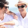 Father and son basking under the sunlight together — Stock Photo