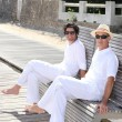 Men sitting on a bench on a sunny day — ストック写真 #7738729