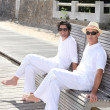Men sitting on a bench on a sunny day — Stockfoto #7738729