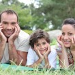 A couple and their son in the park — Stock Photo #7739236