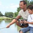 Stock Photo: Father and son fishing