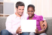 Couple sat on sofa watching laptop screen — Stock Photo