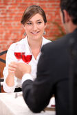 Couple drinking rose wine in a restaurant — Stock Photo