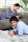 Couple relaxing at home on a Sunday — Stok fotoğraf