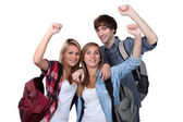Students with arms up — Stock Photo