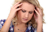 Young woman having a headache — Stock Photo