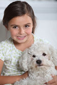 Child with a dog — Stock Photo