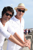 Two men of different generations standing in the sunshine — Stock Photo