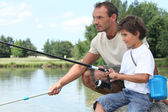 Father and son fishing — Stok fotoğraf