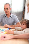 Grandfather playing with his grandson — Stock Photo