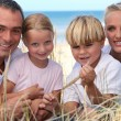 Family spending the day by the seaside — Stock Photo