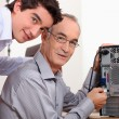Stock Photo: Father and son fixing computer