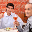 Stock Photo: Father and son having lunch