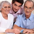 Portrait of grandparents with grandson — Stock Photo