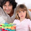 Father and daughter playing with bricks — Stock Photo
