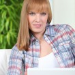 Young redhead woman using laptop at home — Stock Photo
