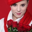 Stylish woman holding a bouquet of red roses — Stock Photo