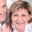 Mature woman and her husband in bathrobes — Stock Photo #7744198