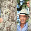 Old man stood between two trees — Stock Photo #7744305