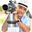 Tourist looking through a telescope — Stock Photo