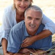 Couple sitting on a sand dune — Stock Photo #7744730