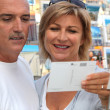 Stock Photo: Couple buying post card