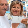 Couple buying post card — Stock Photo #7744921