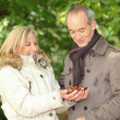 Stock Photo: Couple collecting chestnuts