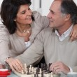 Loving couple playing chess together — Stock Photo #7745691