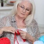 Older woman knitting — Stock Photo
