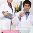 Two scientist with wine in laboratory — Stock Photo