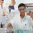 Stock Photo: Female trio in lab with test-tubes