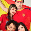 A group of friends supporting the Spanish football team - Stock Photo
