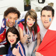 French football fans with a remote control — Stock Photo #7747924