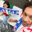 Italian football fans at home - Stock Photo