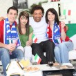Stock Photo: Friends supporting Italifootball team