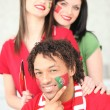 Stock Photo: Three Portuguese football supporters