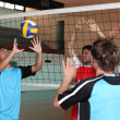 Young men playing volleyball — Stock Photo