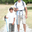 Father and son on a hike — Stock Photo