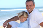 Father with his son at the beach — Stock Photo