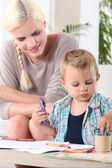 Young boy coloring with wax crayons — Stock Photo