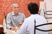 Father and son in the restaurant — Stock Photo