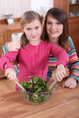 Mother and daughter making a salad together — Stock Photo