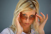 Moody blond woman wearing sunglasses — Stock Photo