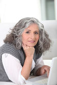 Older woman surfing the internet — Stock Photo