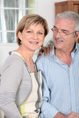 Middle-aged couple in kitchen — Stock Photo