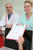Clinician and practical nurse — Stock Photo