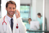Portrait of a doctor on the phone — Stock Photo