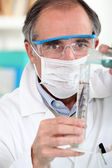 Scientist with a test tube — Stock Photo