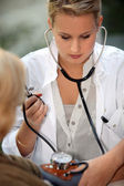 Young intern with patient — Stock Photo